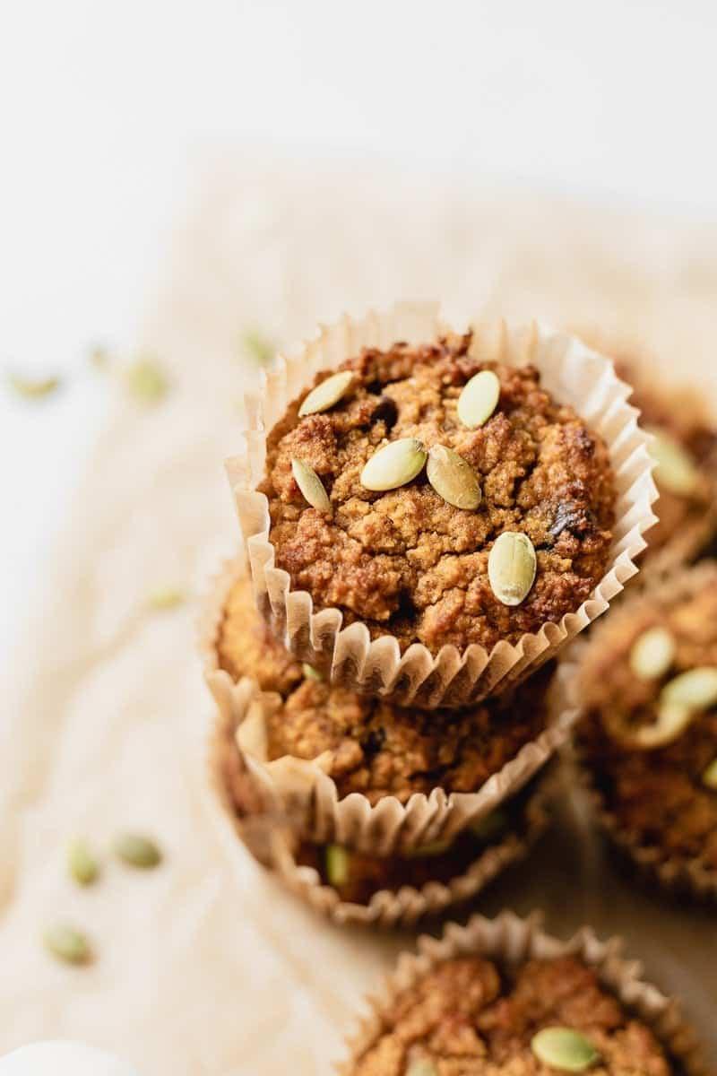 pumpkin almond flour muffins with pumpkin seeds on top