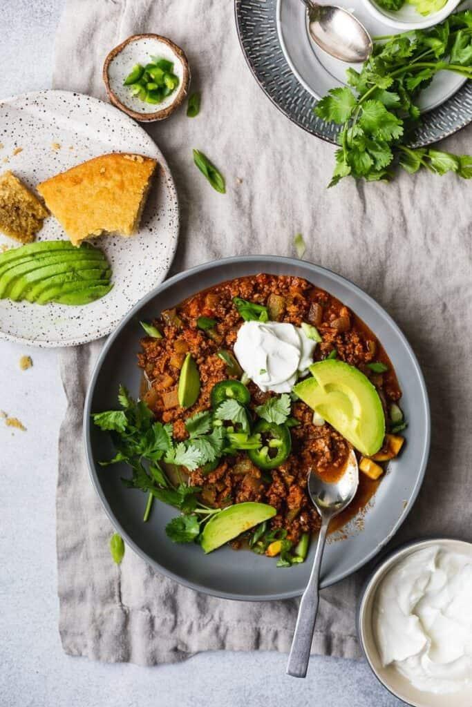 keto chili spread with keto cornbread on the side