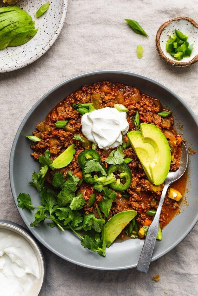 keto chili in a bowl with toppings