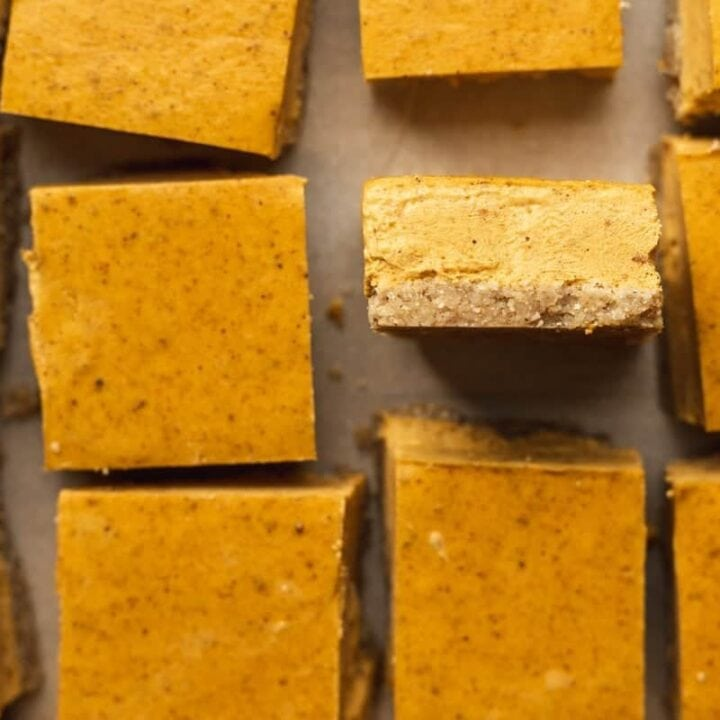 closeup shot of the edge of a keto pumpkin cheesecake bar
