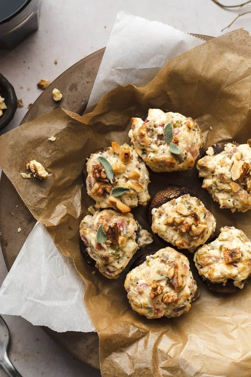 keto stuffed mushrooms on a plate with parchment paper