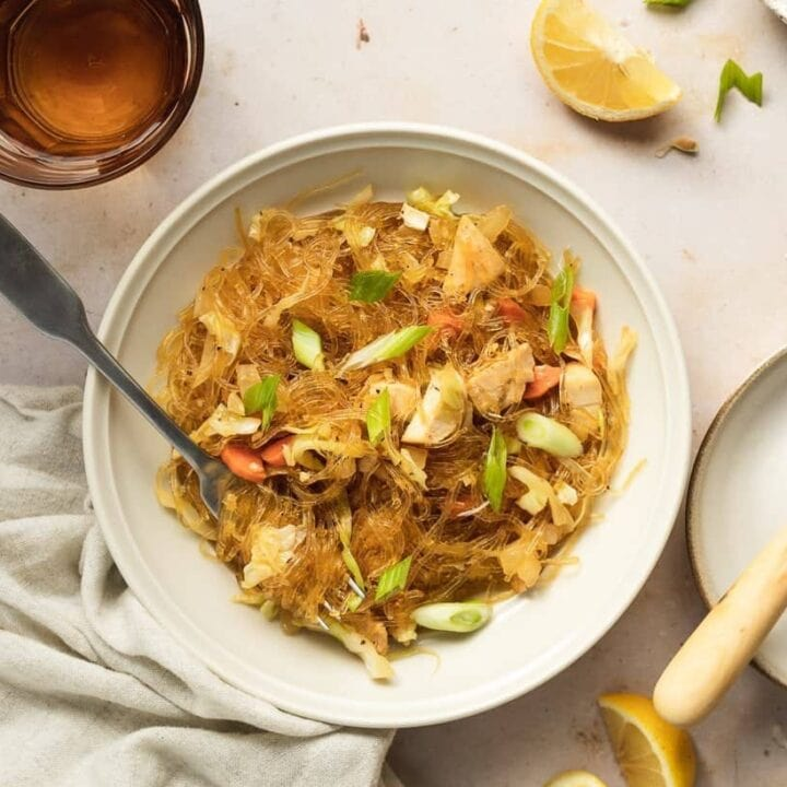 pancit with kelp noodles in a bowl with a glass and knife for Filipino pancit recipe