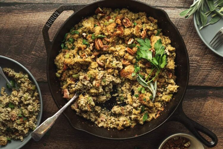 keto cornbread stuffing in skillet with garnishes