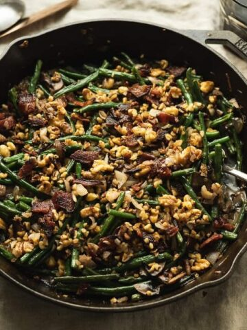 keto green bean casserole on table with serving fork