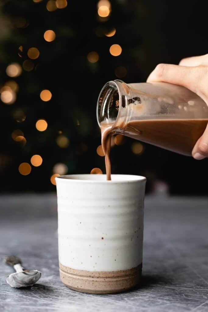 pouring keto hot cocoa into mug