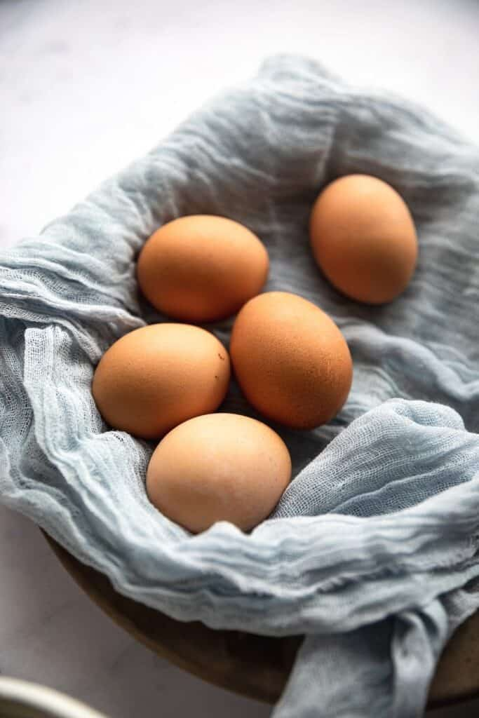 close up of eggs with blue linen
