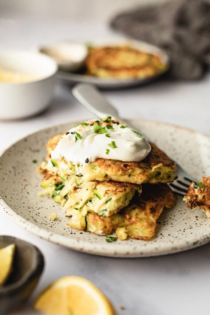These keto zucchini fritters are simple to make, gluten-free, and packed with veggies and protein for a delicious side any time of day!