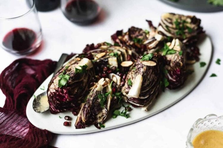 radicchio wedge salad on platter with toppings