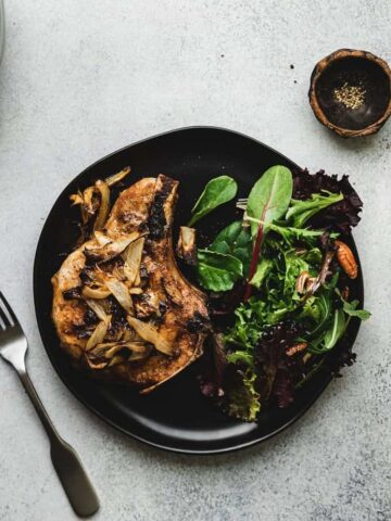 overhead of air fryer pork chop on a plate with salad
