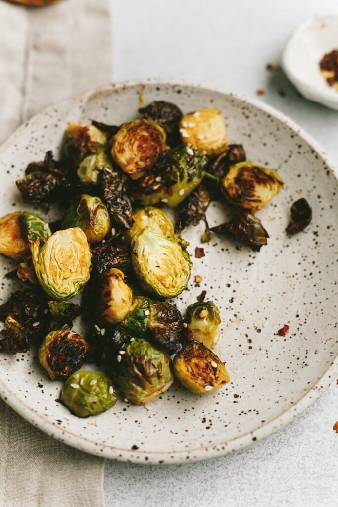 crispy sriracha Brussels sprouts on a plate