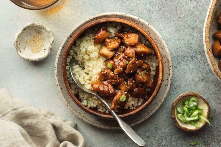 keto bourbon chicken with cauliflower rice and green onions