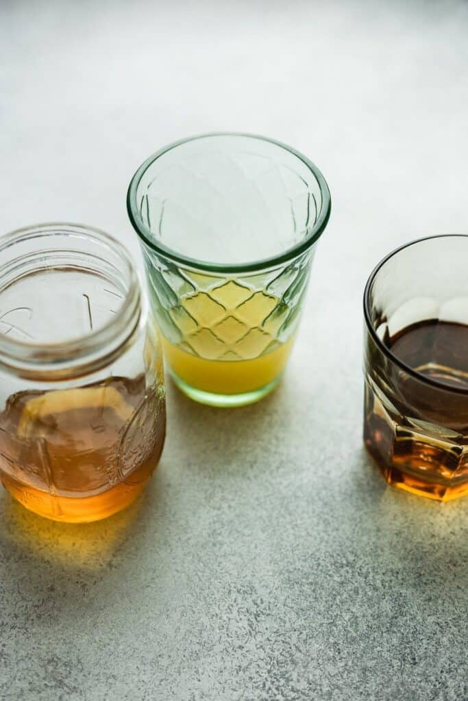 three glasses with ingredients for keto bourbon chicken recipe