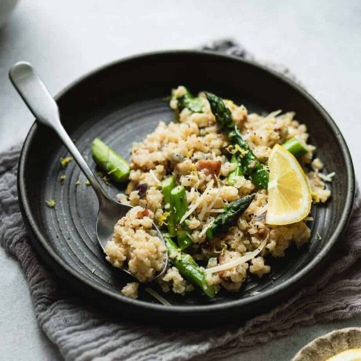 cauliflower risotto on a plate with a spoon HERO