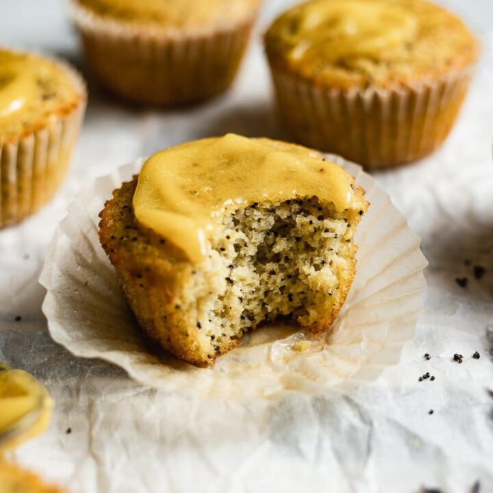 horizontal image of a bite taken out of a coconut flour muffin