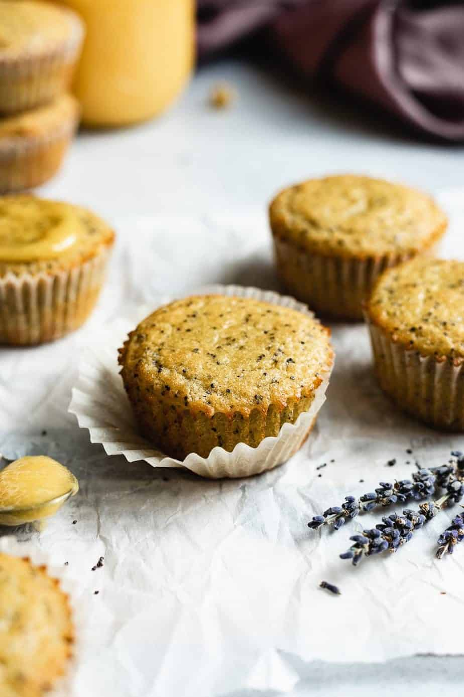 keto lemon poppy seed muffins with lavender in the foreground