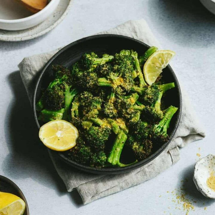 keto air fryer broccoli with lemon wedges