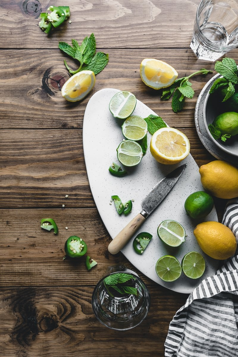 flatlay of limes and lemons on a wood table