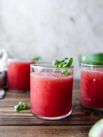 watermelon slushies in a glass with basil