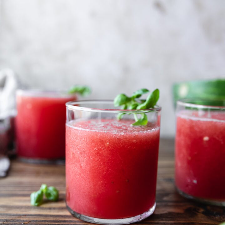 low-carb watermelon slushies in glasses garnished with basil