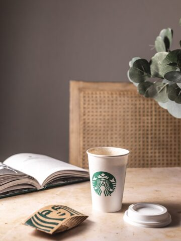 keto Starbucks drink at table with a book