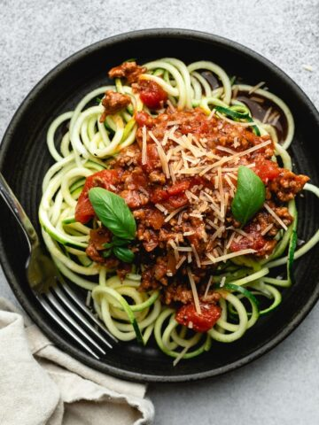 low carb spaghetti sauce with zoodles on a black plate