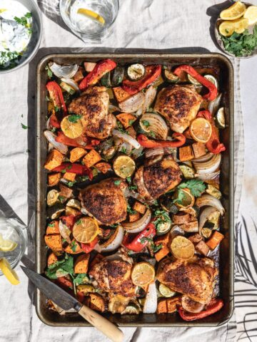 harissa chicken thighs on a sheet pan with vegetables for keto chicken thigh recipes roundup