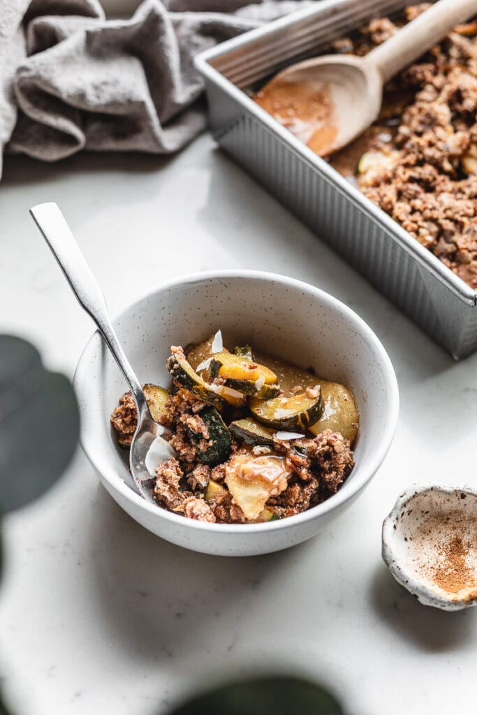 bowl of keto apple zucchini crisp with a spoon