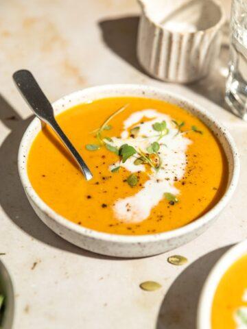 bowl of keto pumpkin soup with coconut cream