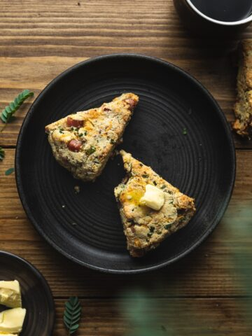 savory keto scones on a black plate with coffee