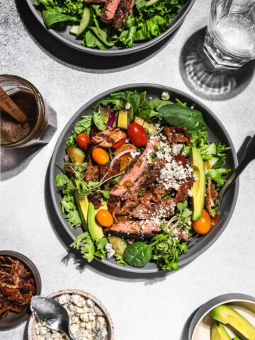 keto steak salad flatlay with ingredients and water glasses