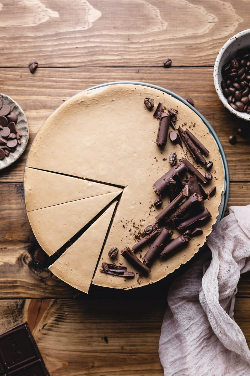 whole keto coffee cheesecake with slices cut