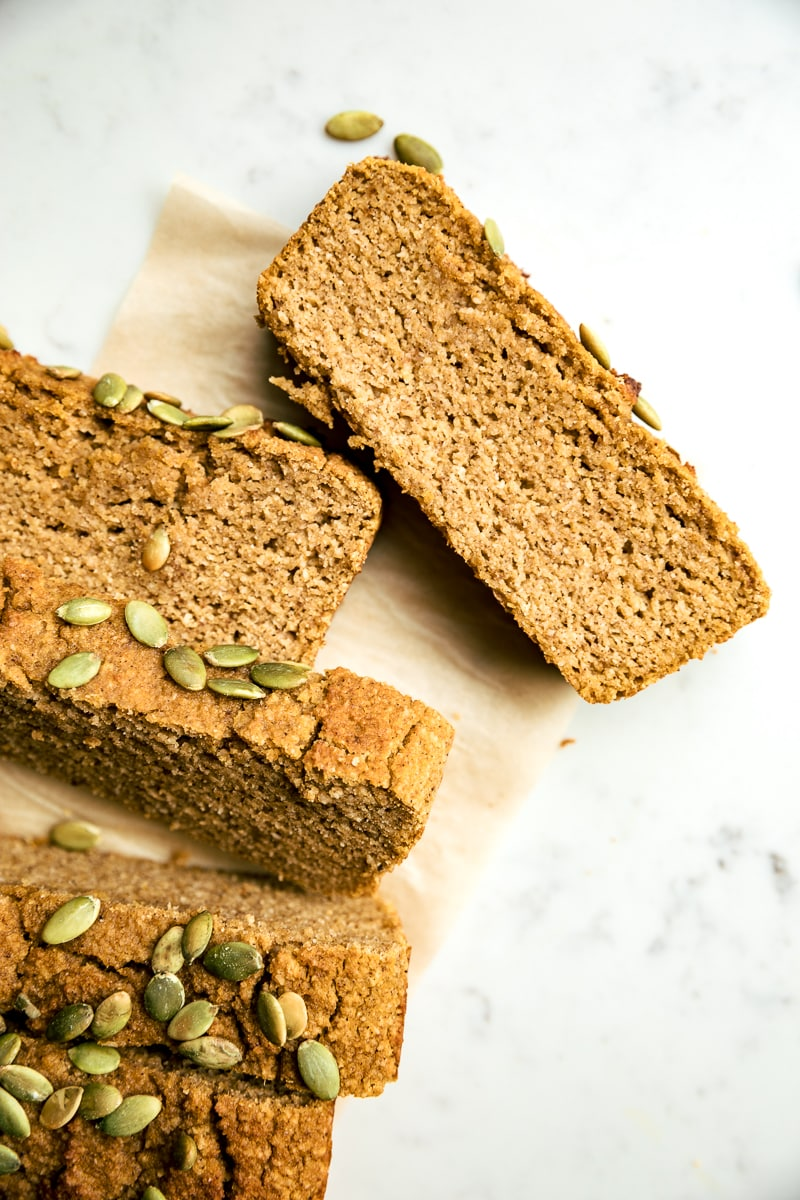 slice of healthy pumpkin bread on parchment paper