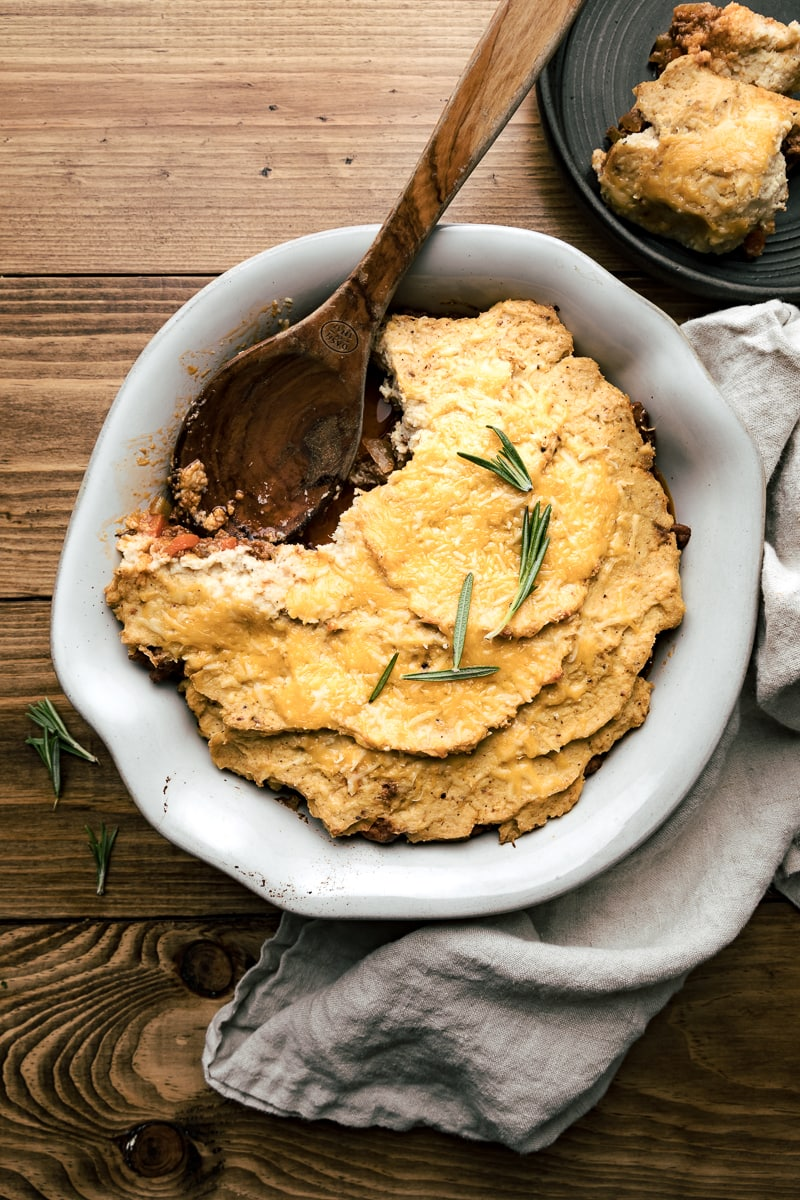 keto shepherd's pie with wooden spoon and rosemary
