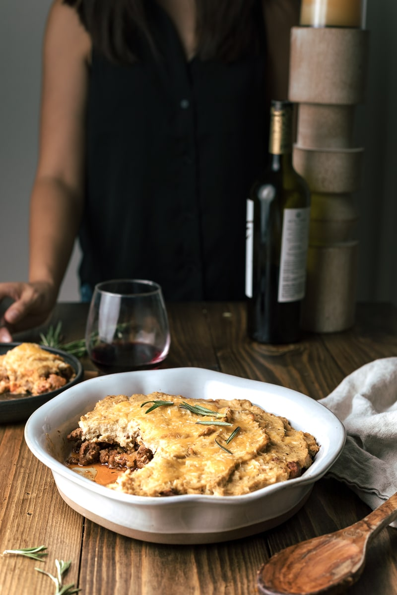 keto shepherd's pie with bottle of wine set at a table
