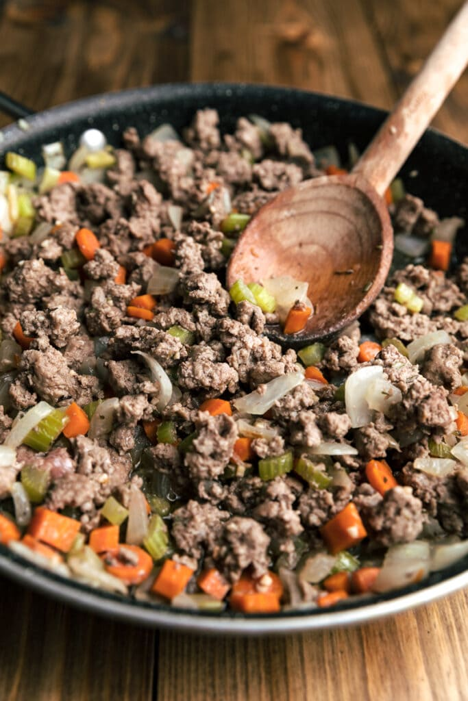 ground lamb in pan with veggies